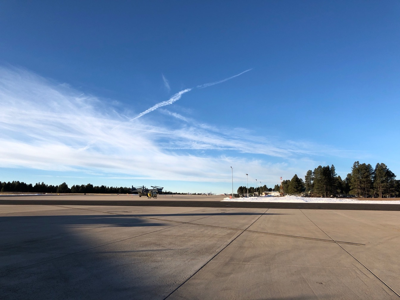 Airport tarmac, blue sky and a few streaky winter clouds