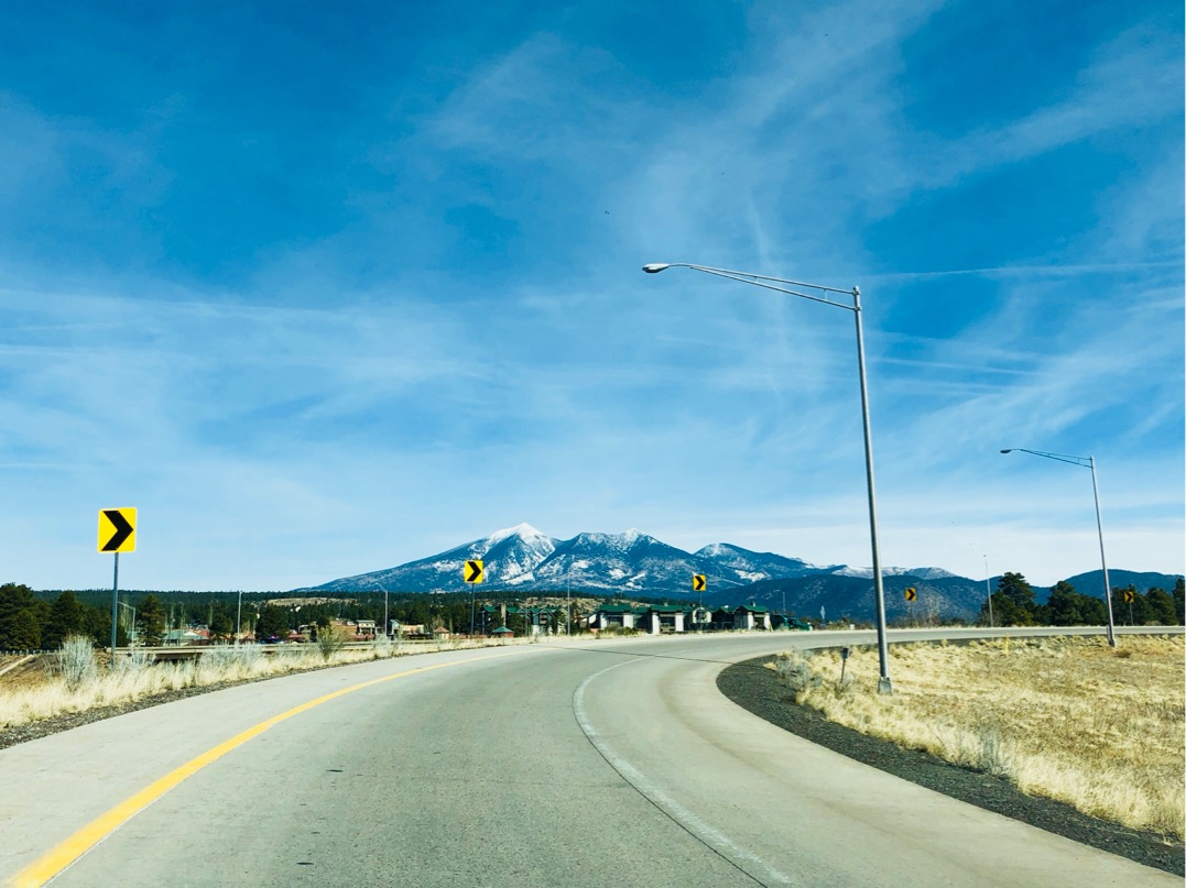 View of the San Francisco Peaks with a little snow, on the horizon.