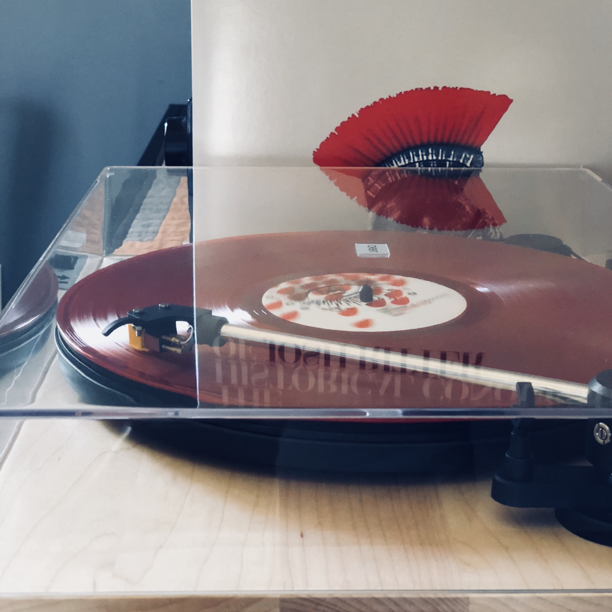 "Photo of a red vinyl album on a turntable — Josh Ritter's ""Historical Conquests of Josh Ritter."""