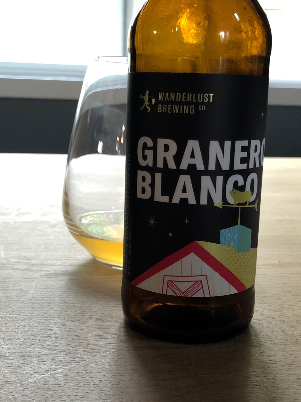 A photo of a bottle of Granero Blanco from Wanderlust Brewing.