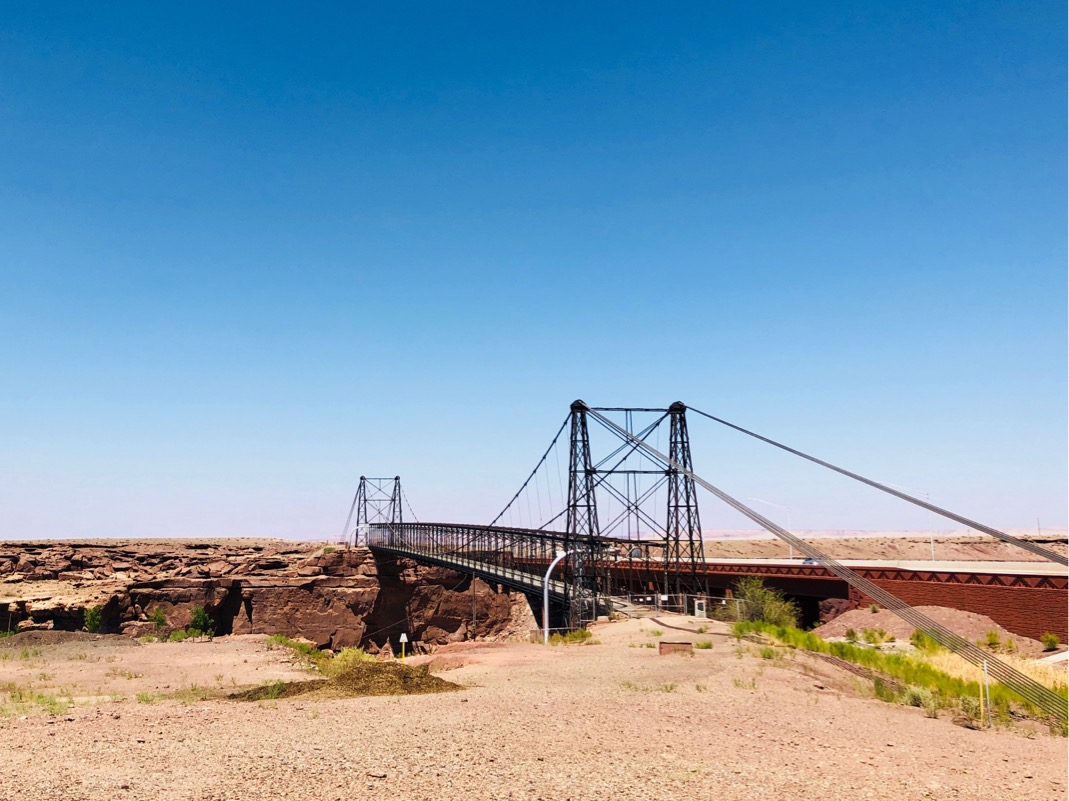Photo of a bridge spanning a canyon from foreground to background.