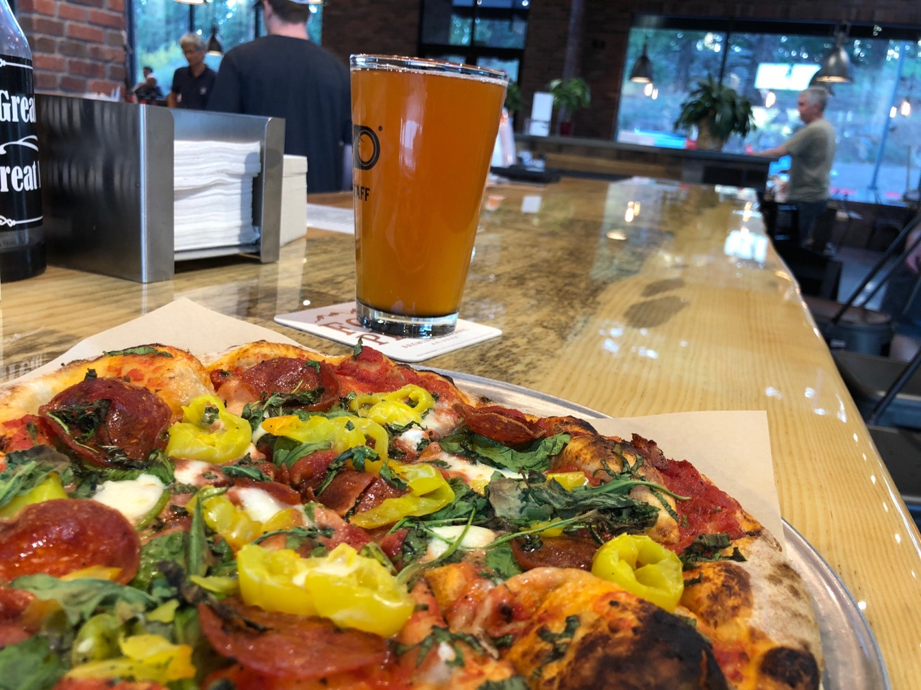 Pizza and beer on a countertop
