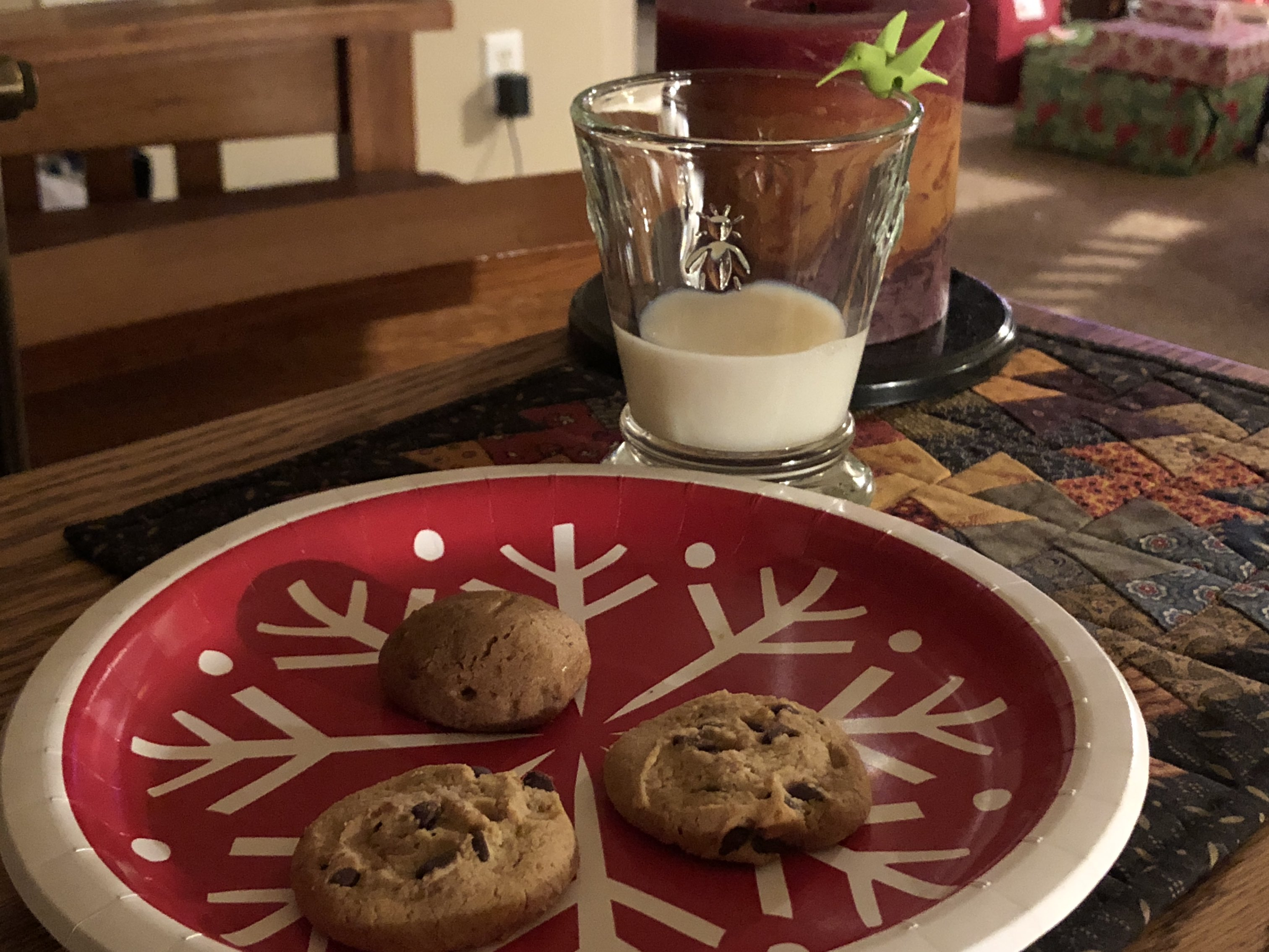 Photo of a glass of milk and small plate of cookies.