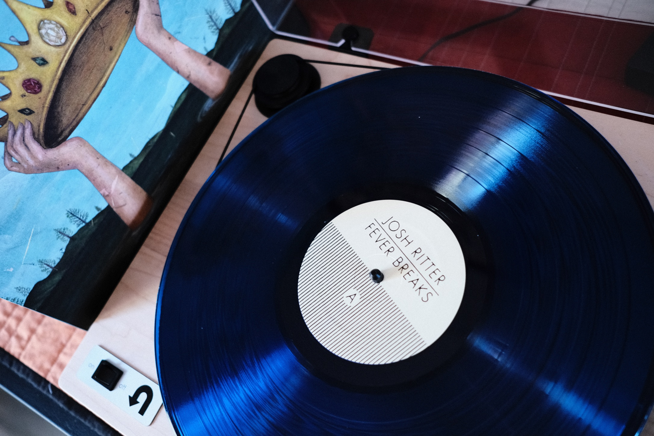 """Photo of album """"Fever Breaks"""" on a turntable"""