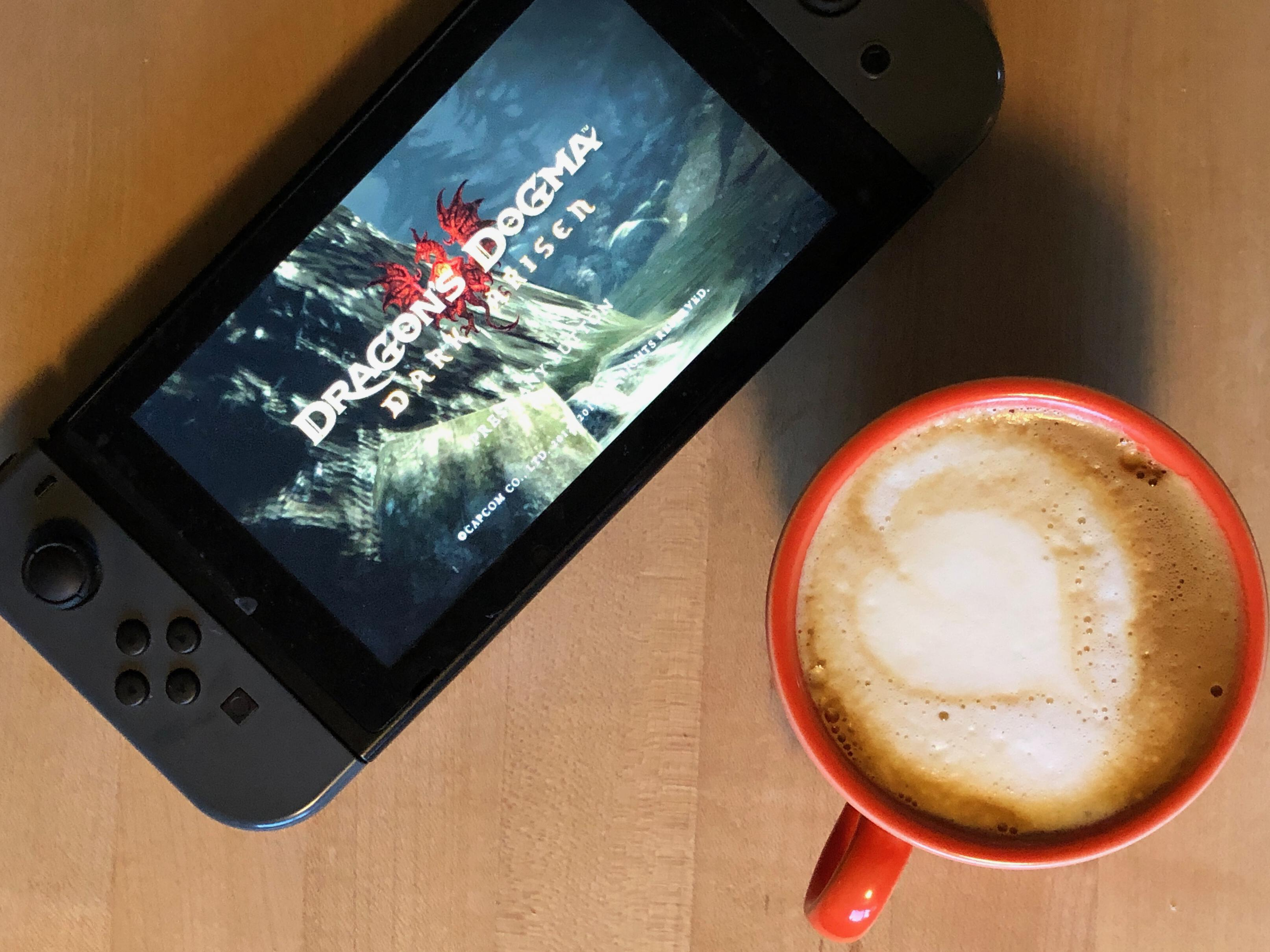 Cappuccino and a Switch with Dragon's Dogma on the screen