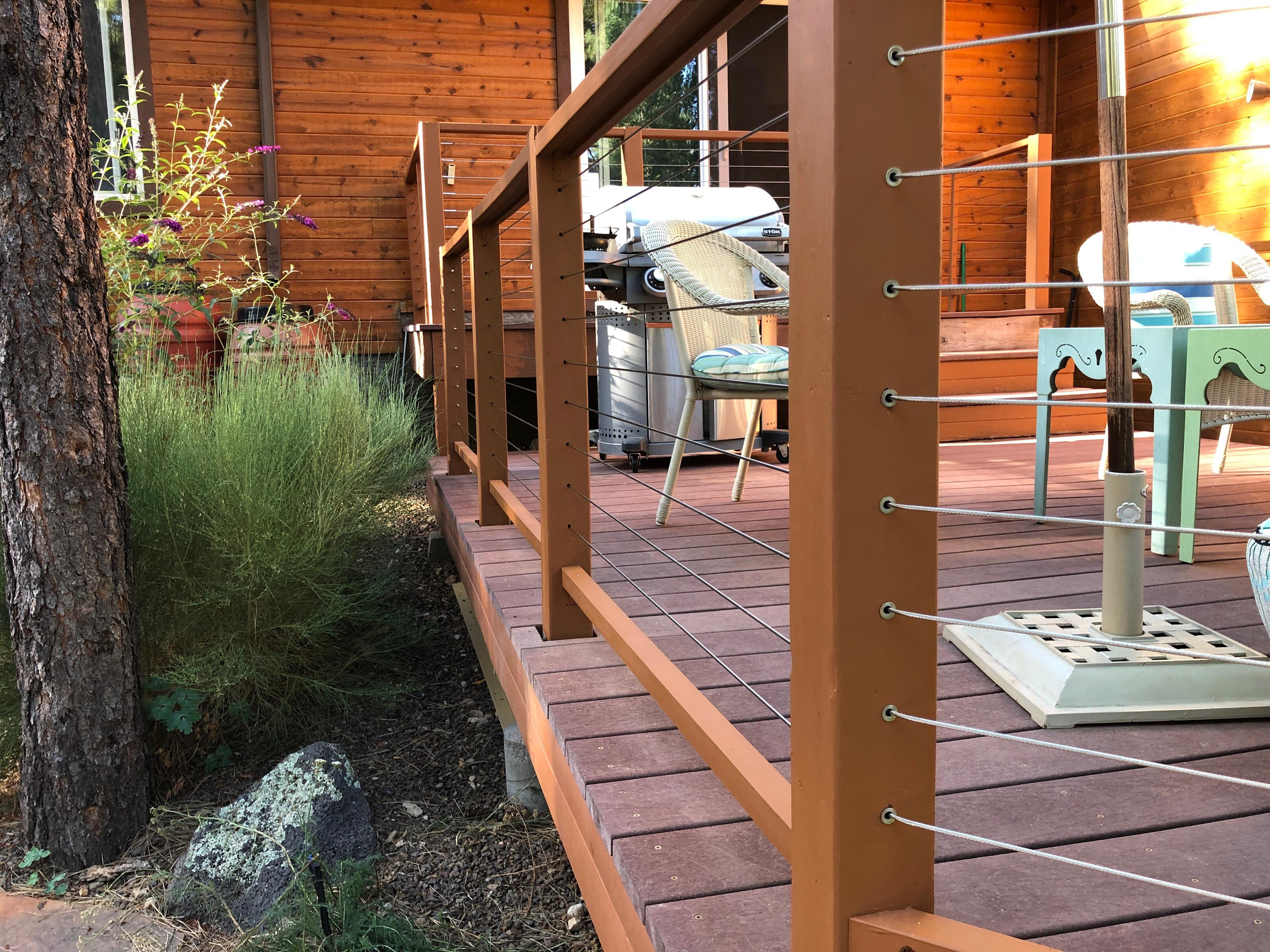 Photo of a deck with steel cable railing