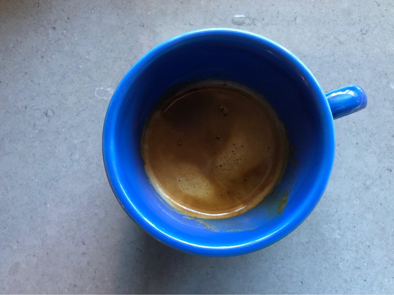 Photo of a blue mug of espresso