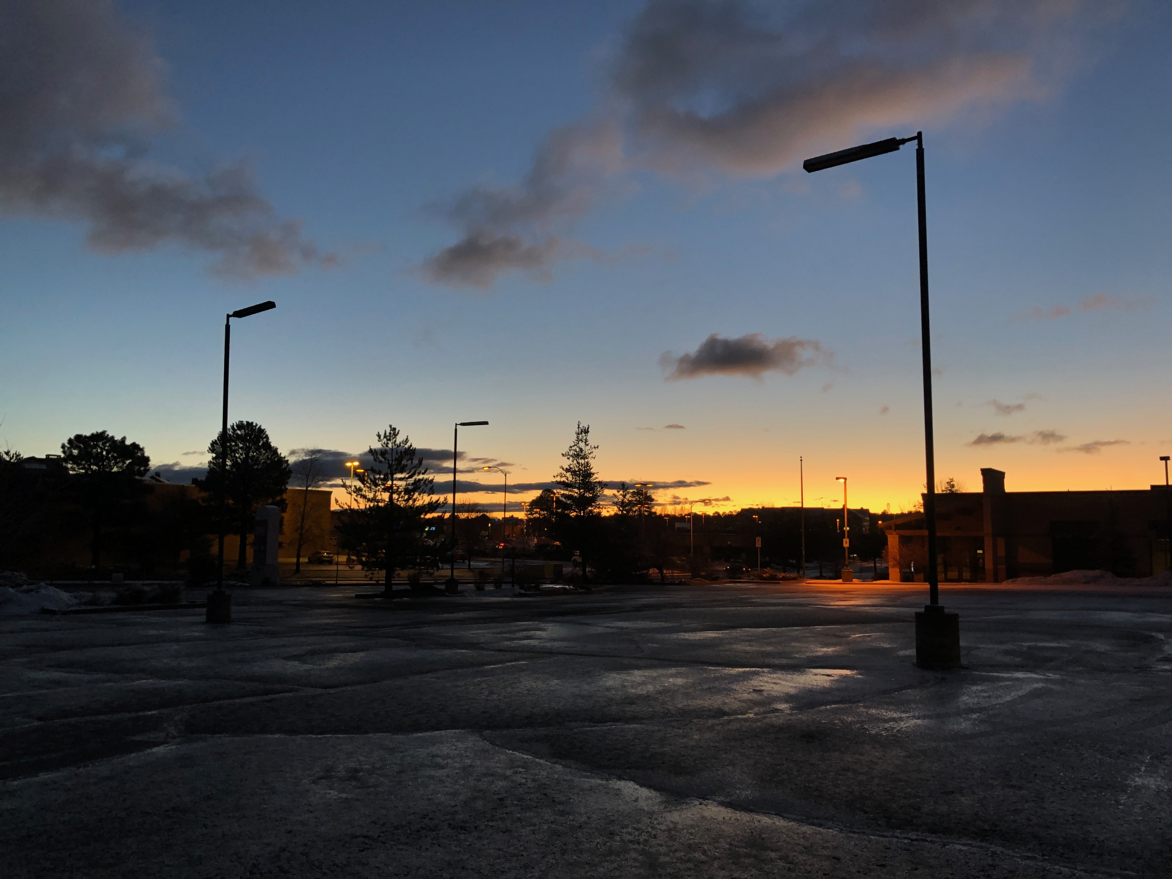 Photo of sunrise over an empty parking lot