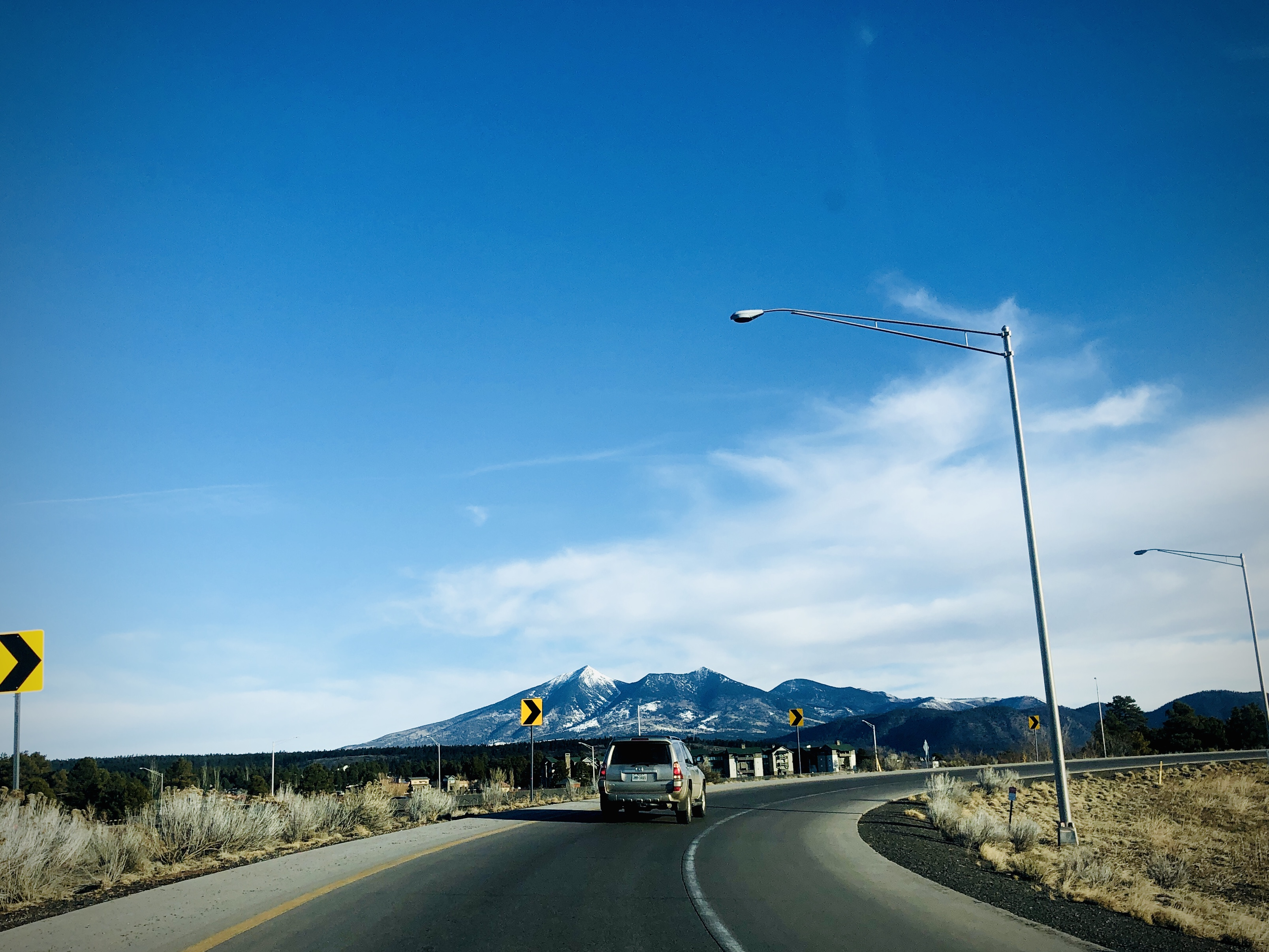 Photo of the San Francisco peaks from a curving highway