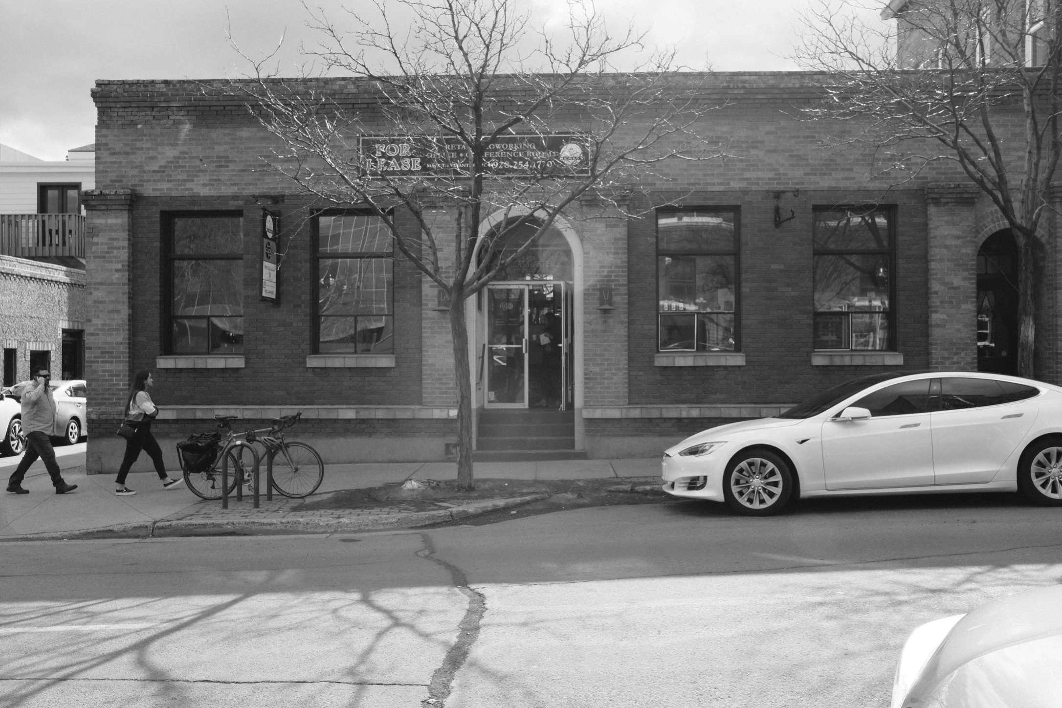 Black and white image of an unassuming brick building