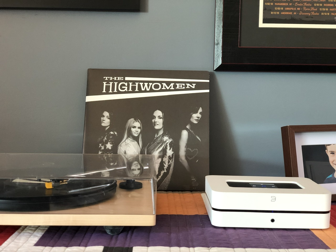 A record player with the album The Highwomen next to it