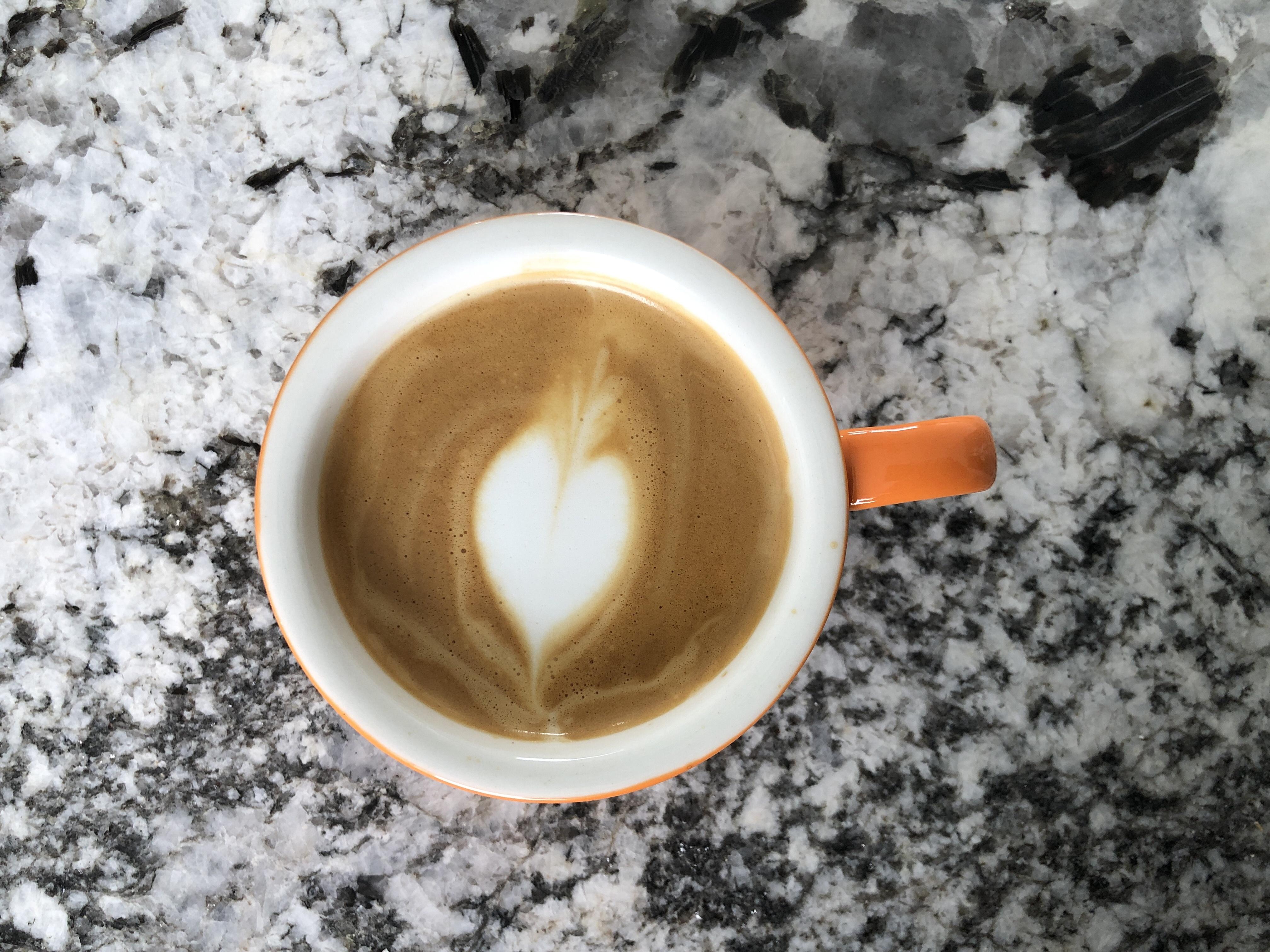 Cappuccino in an orange mug