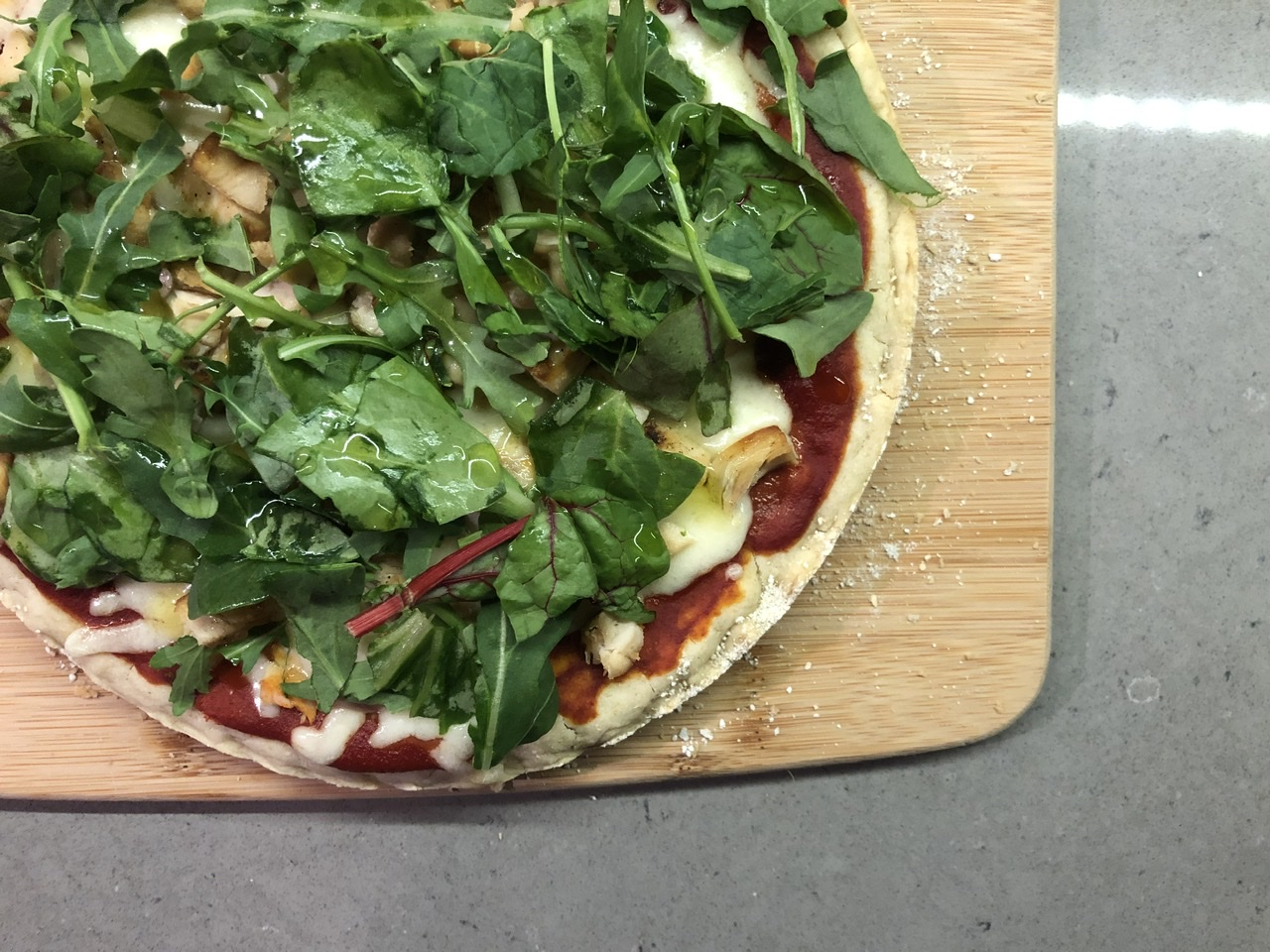 Top down photo of a pizza on a cutting board